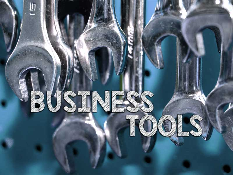 Image of spanners to indicate business tools with wording on top.
